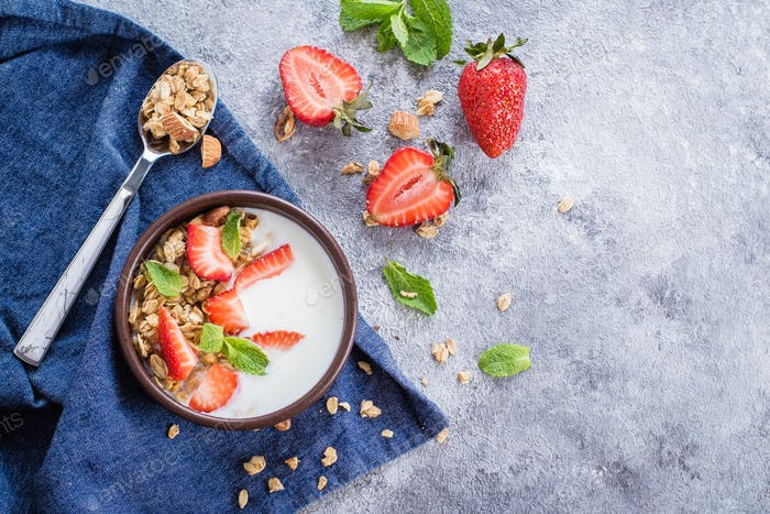 Food Background. Breakfast with yogurt, granola and strawberries. Healthy Diet Food Concept