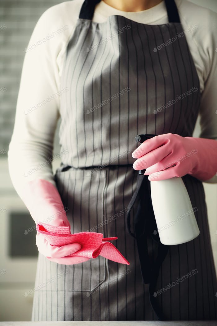 Woman in pink rubber protective gloves wiping dust and dirty. Cleaning concept, banner, copy space