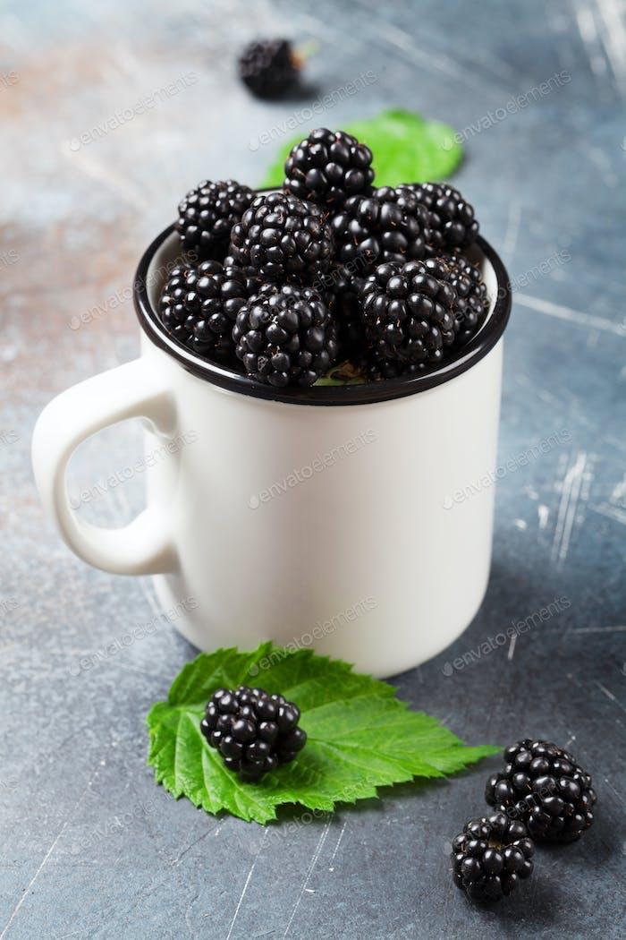Cup of ripe blackberries
