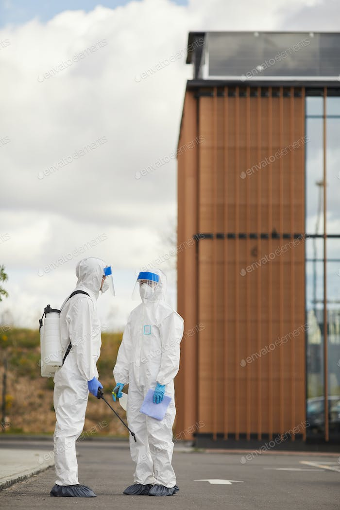 Disinfection Workers Standing in Street