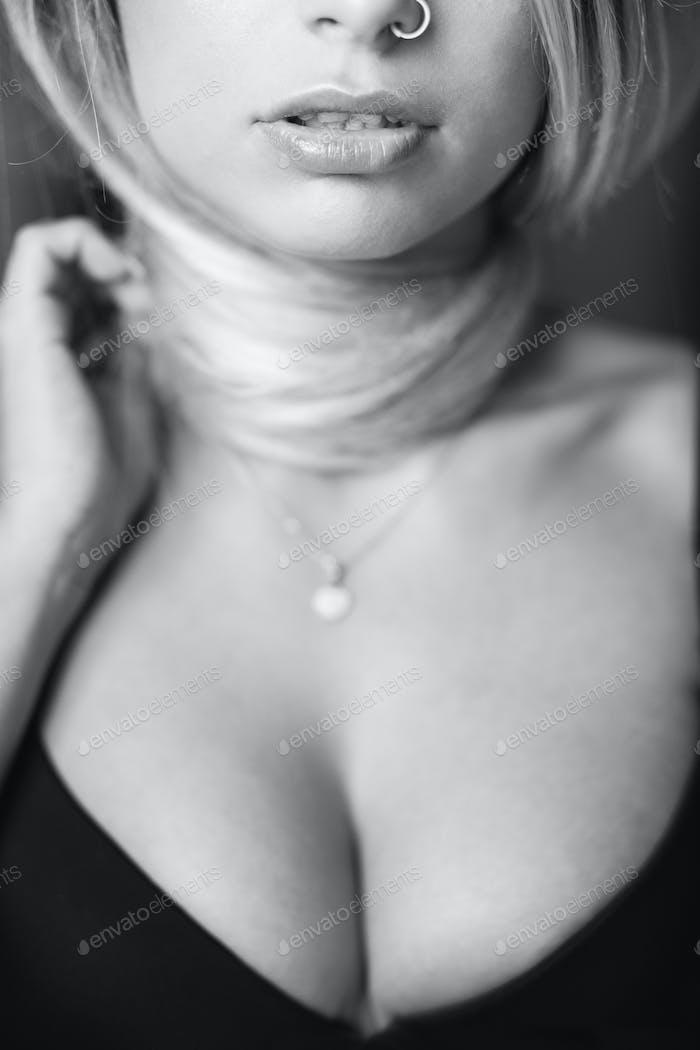 Sexy blonde woman portrait in black lingerie