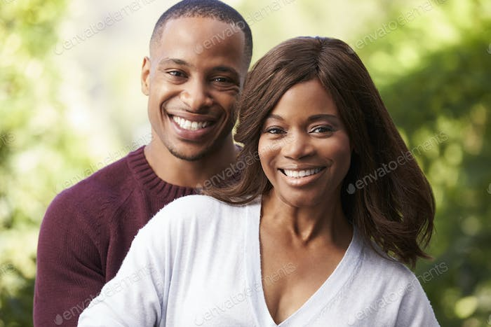 Outdoor Head And Shoulders Portrait Of Romantic Couple