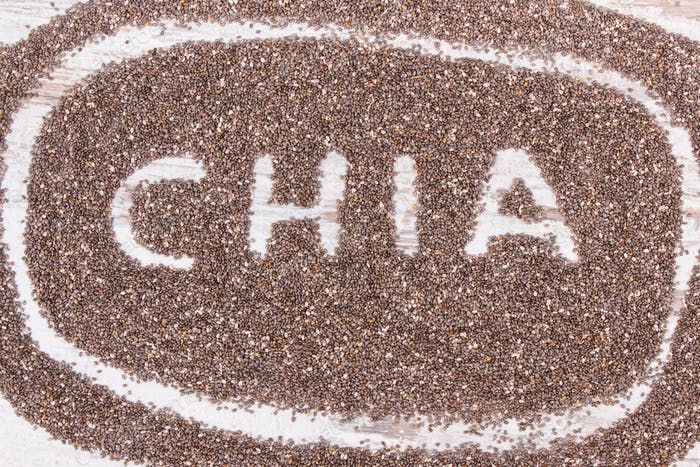 Heap of chia seeds, concept of food containing natural vitamins, fiber and minerals