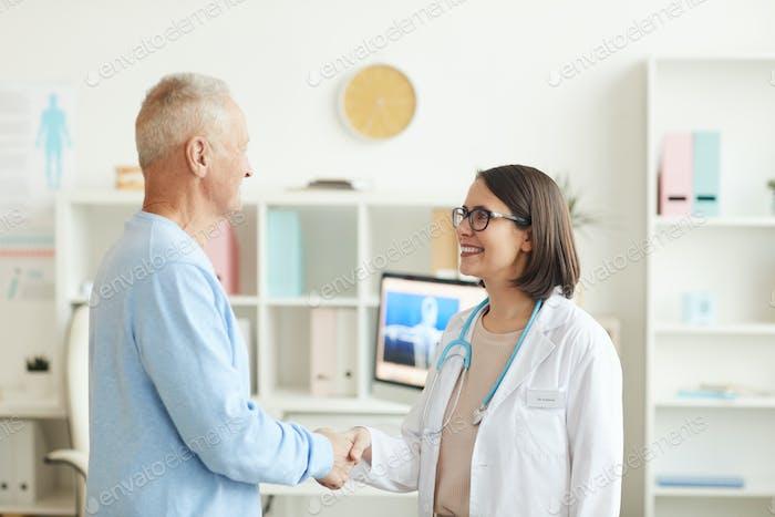 Grateful Senior Man Shaking Hands with Doctor