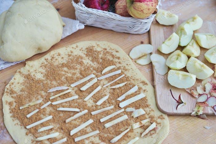 Homemade cinnamon apple roll on table
