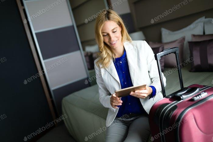 Portrait of attractive businesswoman in hotel room