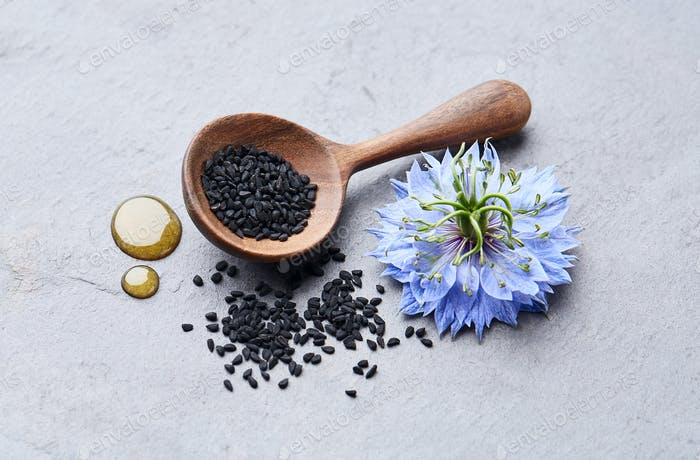 Black cumin seeds with nigella sativa flower