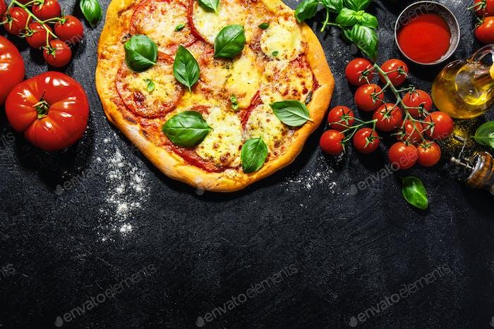 Homemade pizza with mozzarella on dark background
