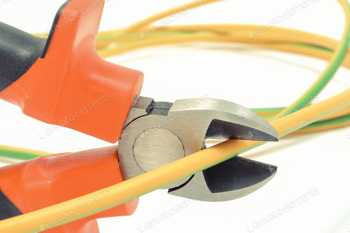 Metal pliers and cable on white background. Technology concept