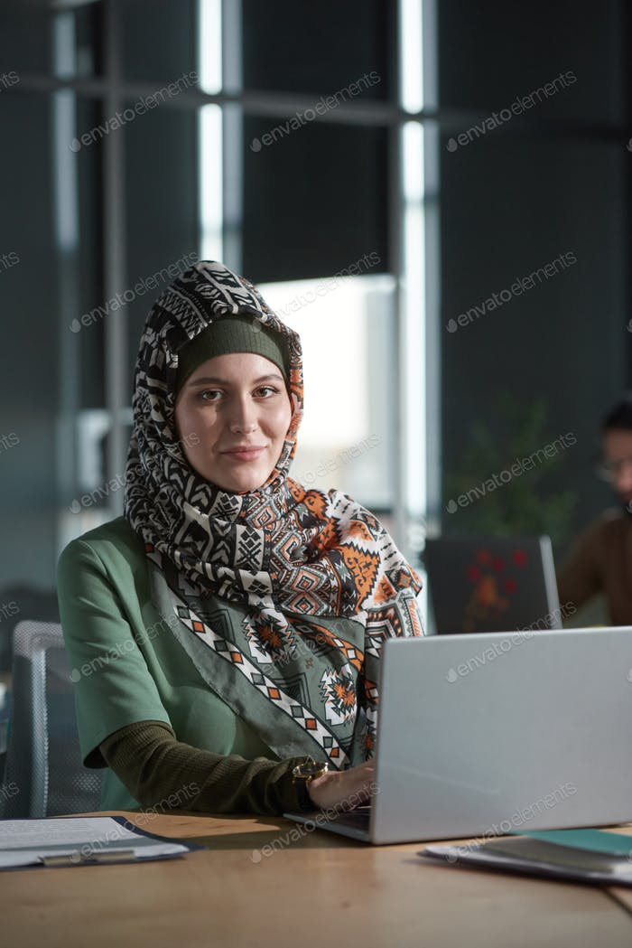 Muslim woman working at office