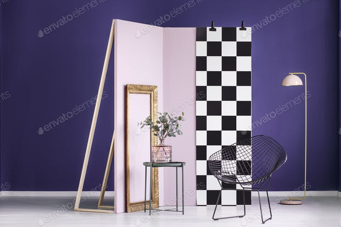 Violet studio interior with plant