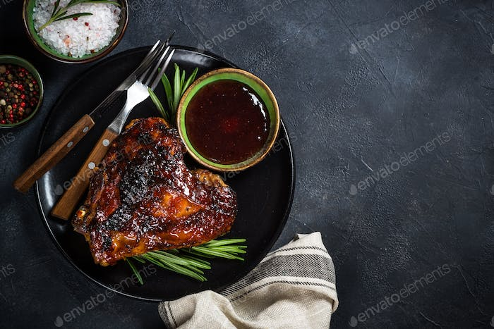 Baked turkey thigh with sauce and herbs