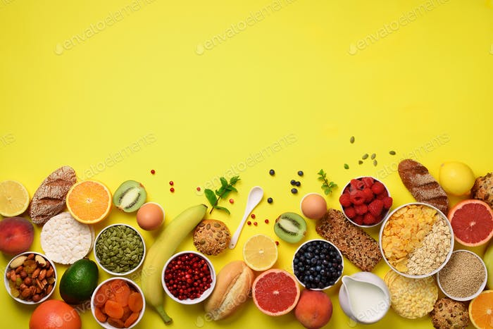 Healthy breakfast ingredients, food frame. Oat and corn flakes, eggs, nuts, fruits, berries, toast