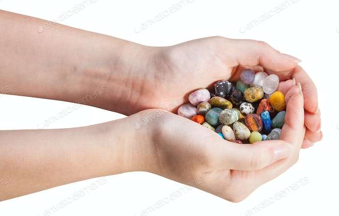 many various gems in handful isolated
