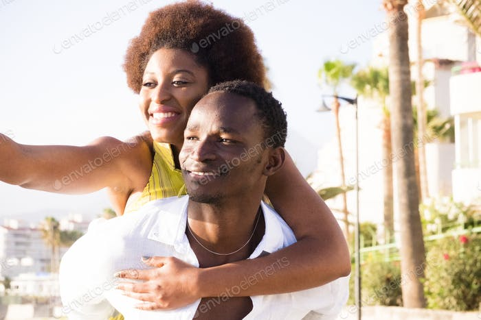 Black people young couple have fun and laugh enjoying the outdoor leisure activity together