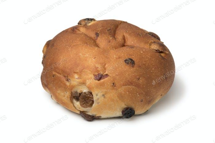 Single fresh baked raisin bun