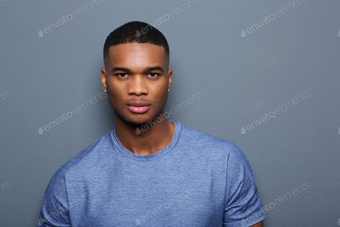 Handsome young black man with serious expression on face