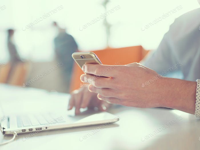 Young man holding smartphone