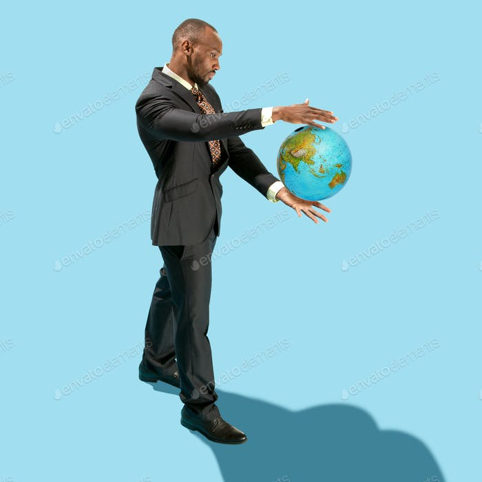 Businessman holding the world in the palm of hands
