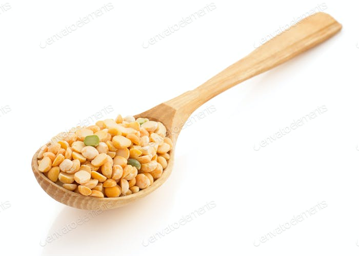 pea grain and wooden spoon