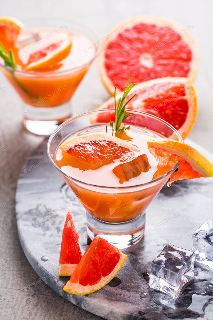 Fresh pink grapefruit drink with juice, cold summer citrus refreshing drink or beverages