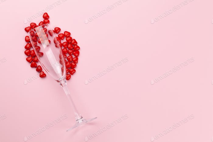 Valentines day with glass and heart sweets