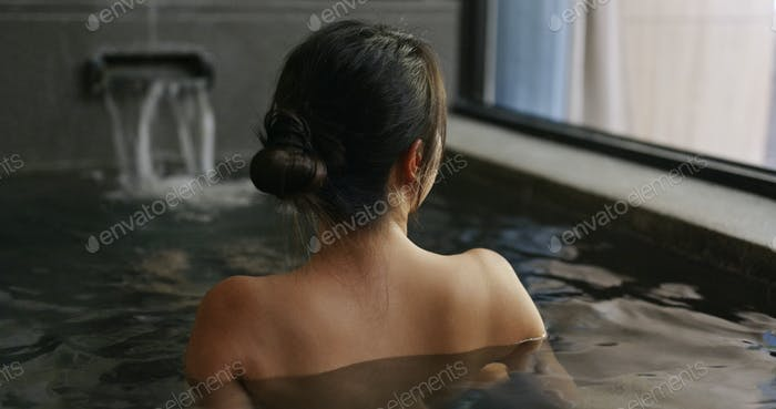 Woman enjoy the Japanese onsen