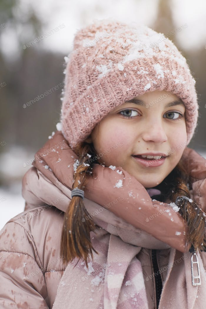 Cute Girl Wearing Pink in Winter