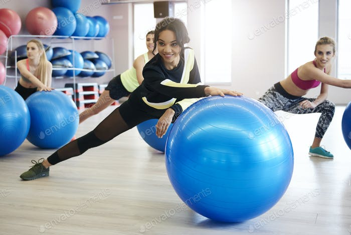 Women exercising with fitness ball