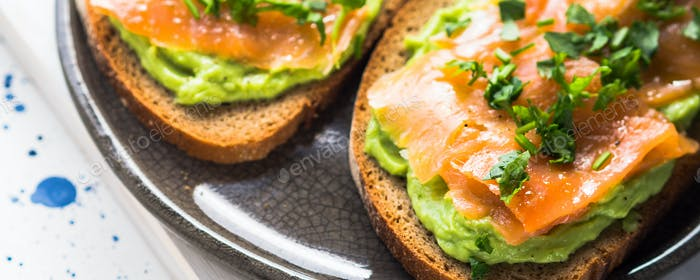 Rye bread avocado toasts with smoked salmon