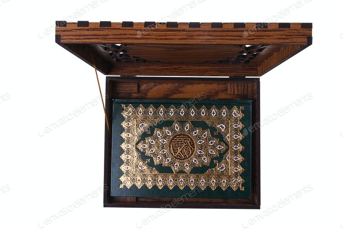 Qur'an in an opened box isolated top view.