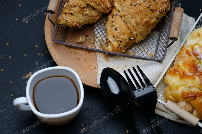 Sesame seed croissants with a cup of black coffee
