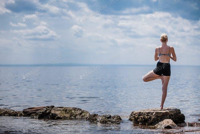 Young Woman doing Yoga Tree Position