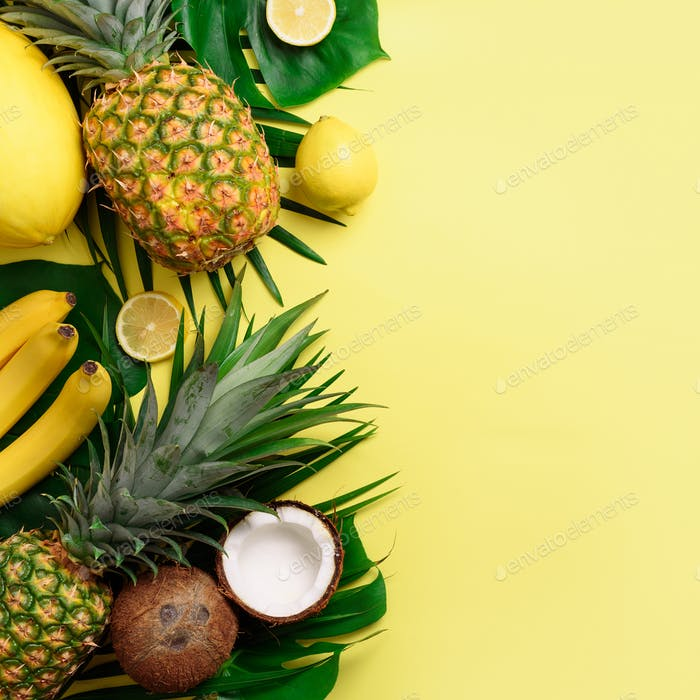 Exotic pineapples, coconuts, banana, melon, lemon, palm and monstera leaves on yellow, violet