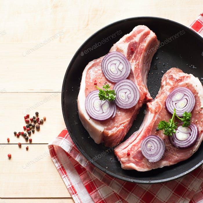 Raw pork  in a frying pan.