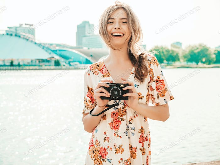 Portrait of young funny woman posing outdoors