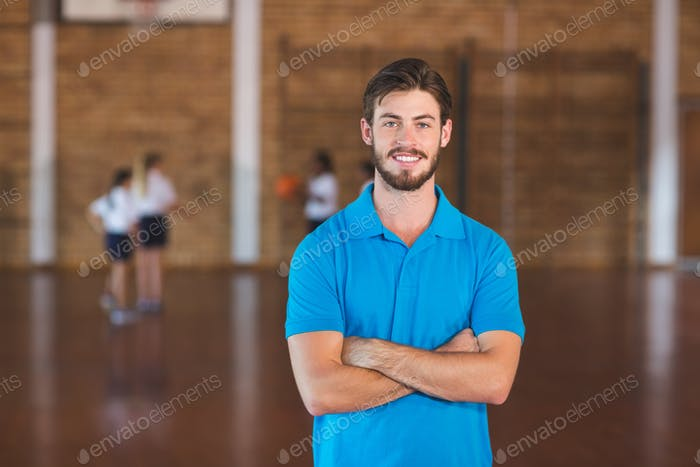 Portrait of sports teacher in basketball court