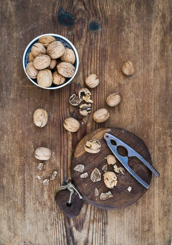 Walnuts in ceramic bowl and on cutting board