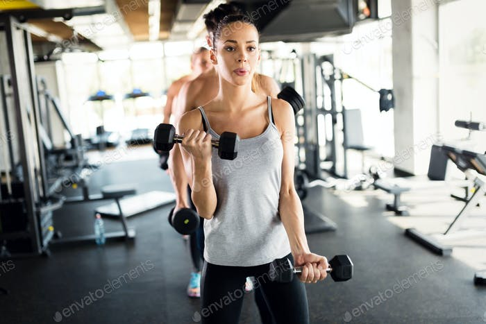 Group of people have workout in gym