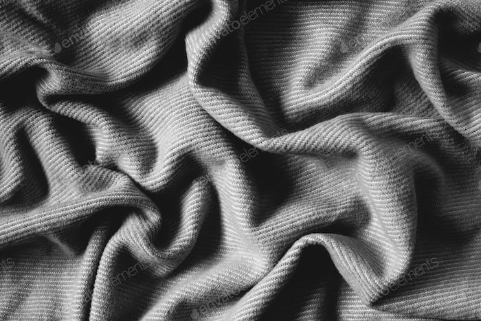 Detail of wrinkles and folds in blanket, overhead view