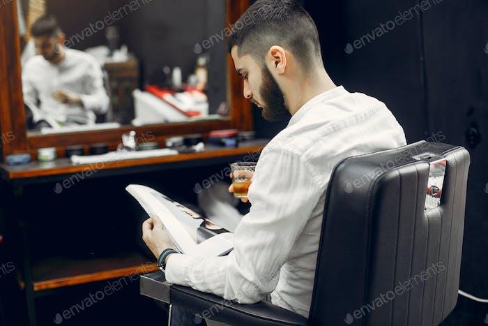 Handsome businessman in a barber shop