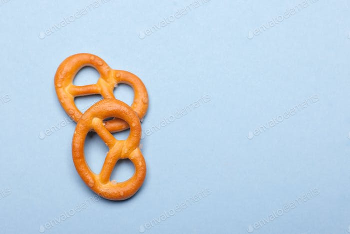 two mini pretzels bakery isolated on blue background with copy space