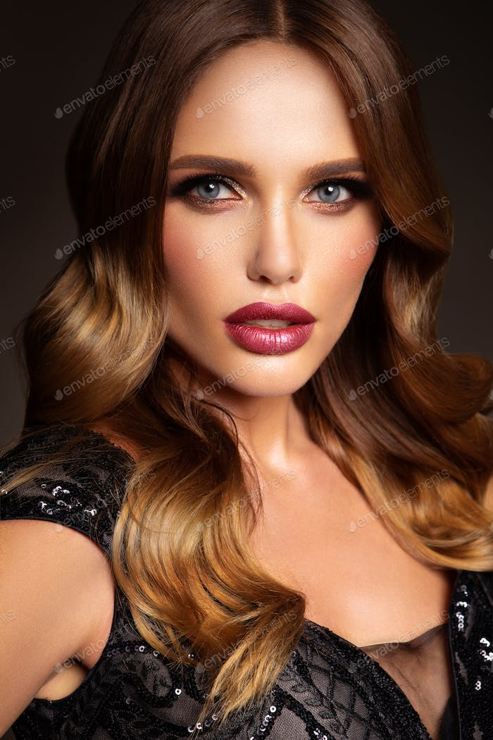 Beautiful model with curly hairstyle. Beautiful make up