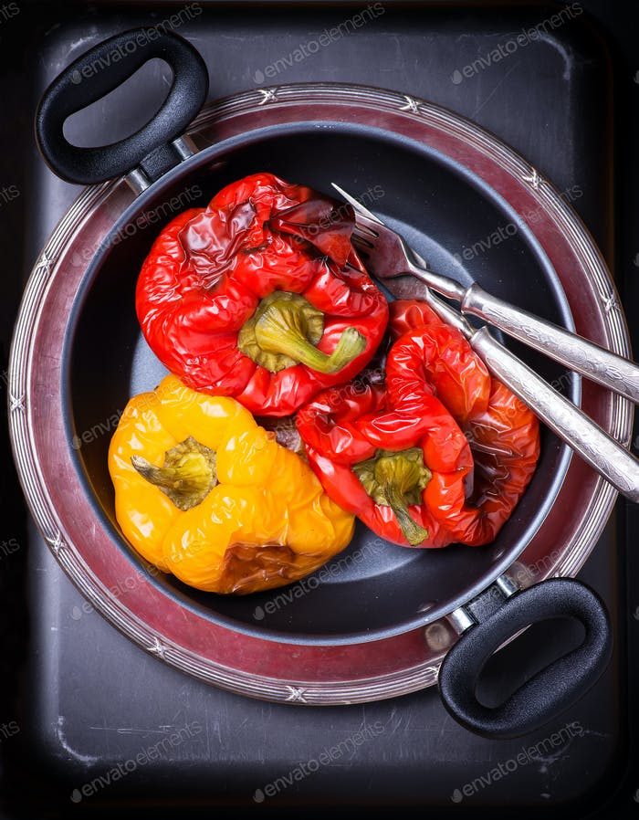 Fresh roasted red and yellow peppers in pot