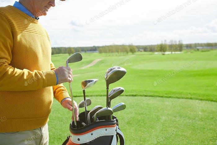 Taking golf club