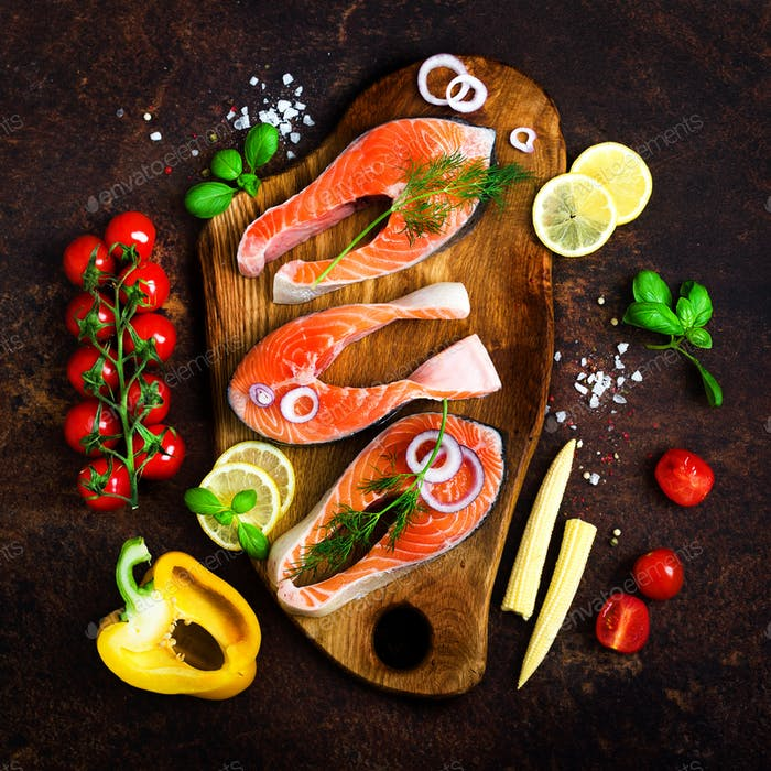 Salmon fillet, fish on wooden background with free space for your text. Top view. Healthy food, diet