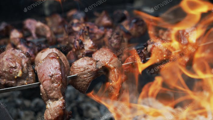Cooking shish kebab or shashlik on skewers