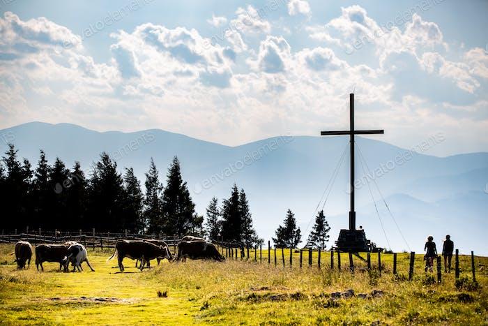 Cross on a peak of Austrian mountain Schockl in Styria Graz