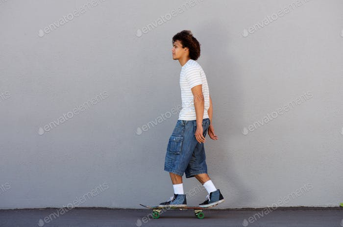 young man skateboarding outside