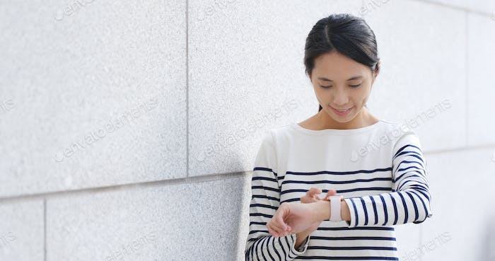 Woman checking schedule on smart watch